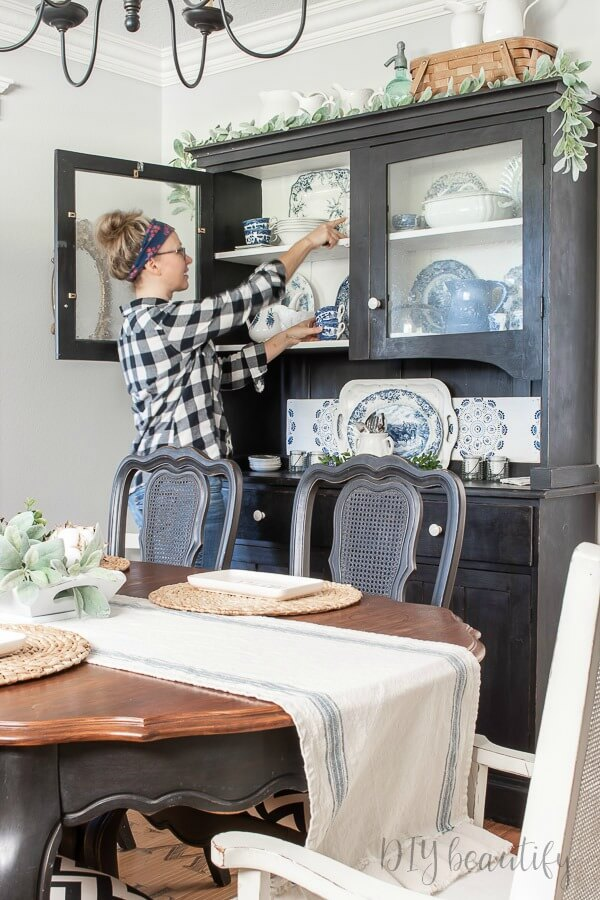 dining room with black chalk painted hutch