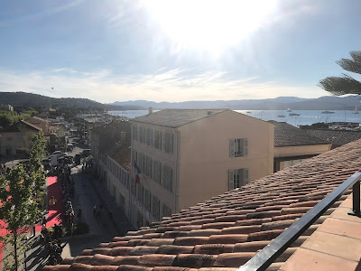 photo from the roof top terrace hotel de paris saint tropez facing the harbor and street