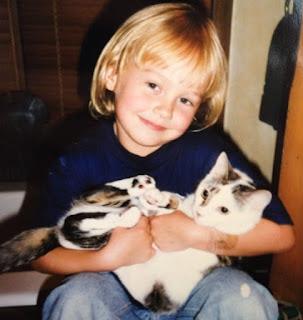Childhood picture of Birgen Anika Hartman with cat