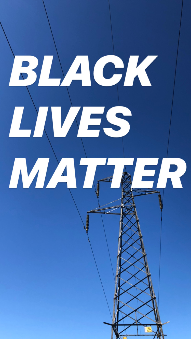 a picture of blue sky and an electricity pylon with the words Black Lives Matter