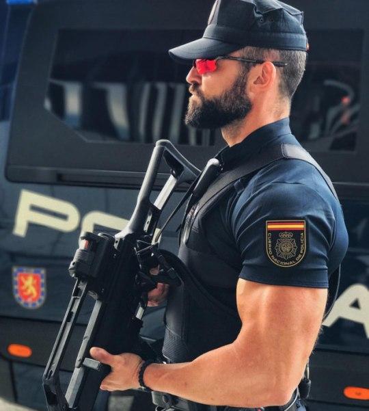 strong-bearded-uniformed-policeman-big-biceps-gun-sunglasses