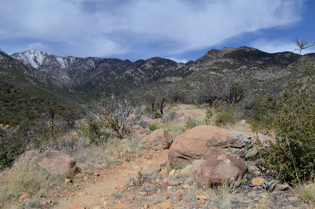 big rock along the trail with Heliograph Peak in view