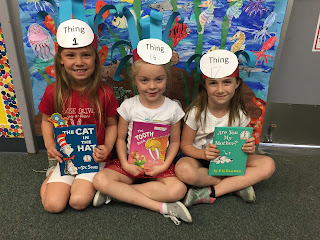 Three girls with Dr. Seuss Books