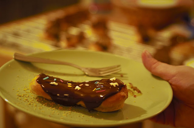 Chocolate-glazed mango eclair