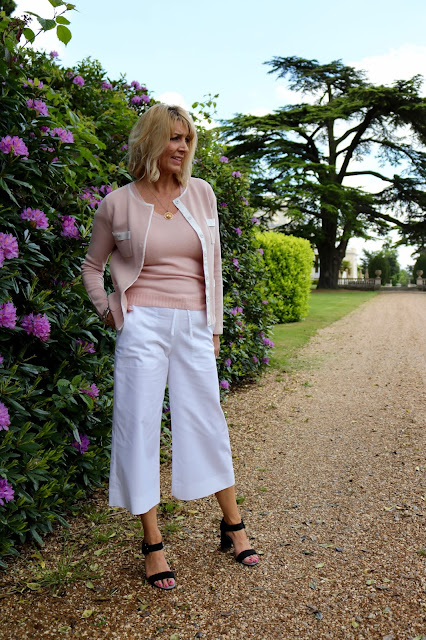 blush cardigan and wide leg cropped trousers in white