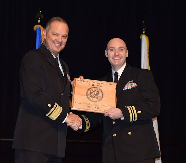 Lt. Cmdr. Cody Schaal accepting an award.