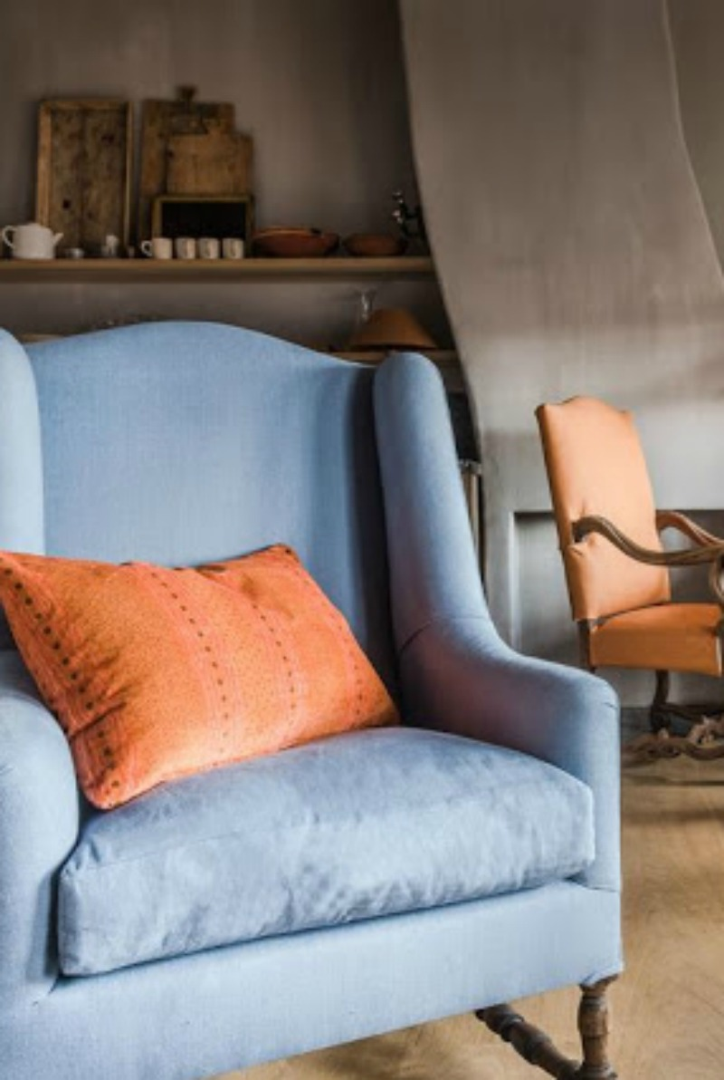 Gorgeous blue wing chair in Belgian style living room - found on Hello Lovely Studio
