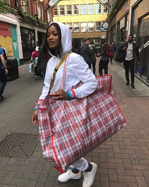 Actress Keke Palmer pictured with Ghana must Go Bag