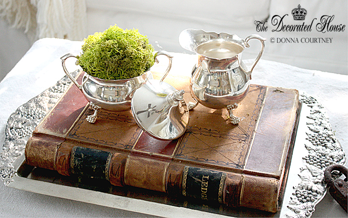 The Decorated House :: Antique Books with Vintage Silver and Moss - Living Room Ottoman