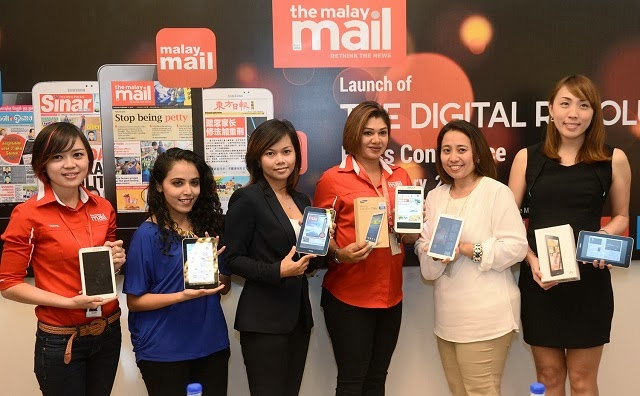 Malay Mail ladies with phablets
