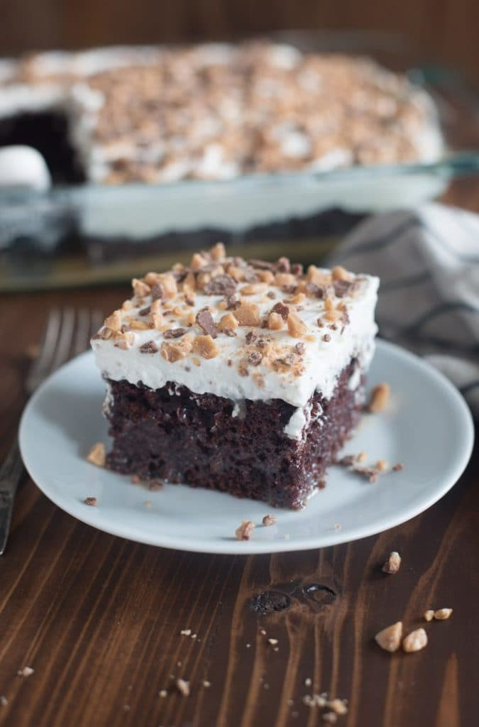 This cake gets it's name for a reason! Chocolate poke cake with caramel and sweetened condensed milk, topped with fresh whipped cream and heath bits.