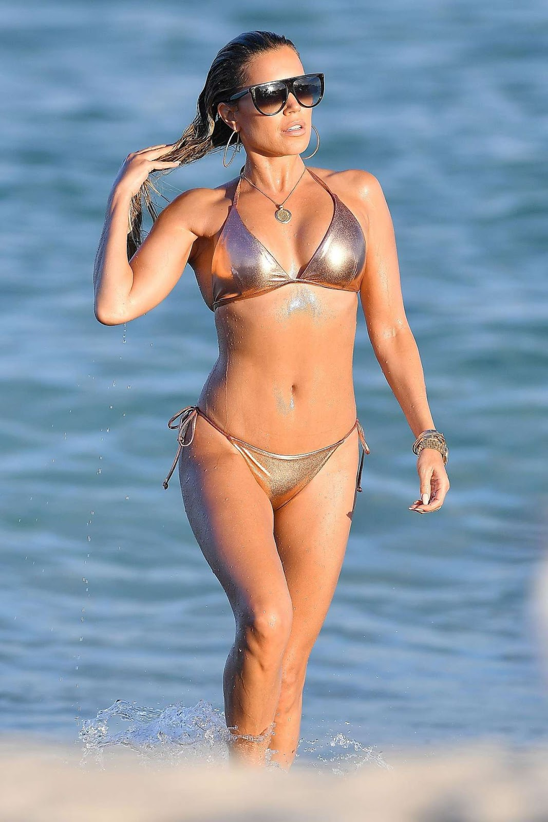 Sylvie Meis shows off envy inducing bikini body in barely there metallic two-piece on Miami beach