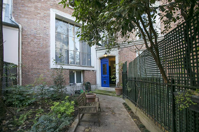 Bright blue door to home on private secret Avenue Frochot in Paris seen on Hello Lovely Studio