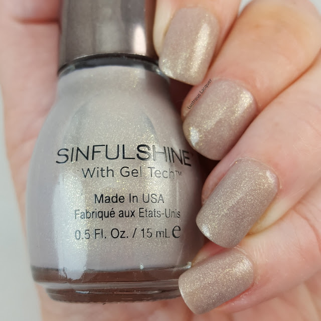 beige-nail-polish-with-golden-flecks