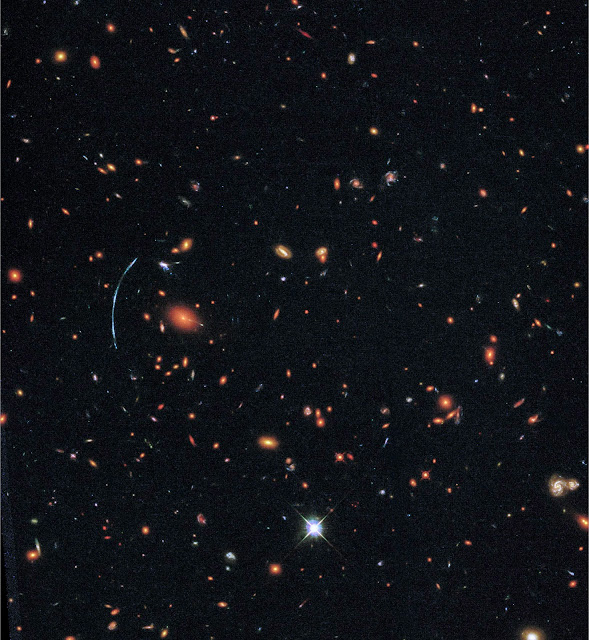 Hubble pushed beyond limits to spot clumps of new stars in distant galaxy