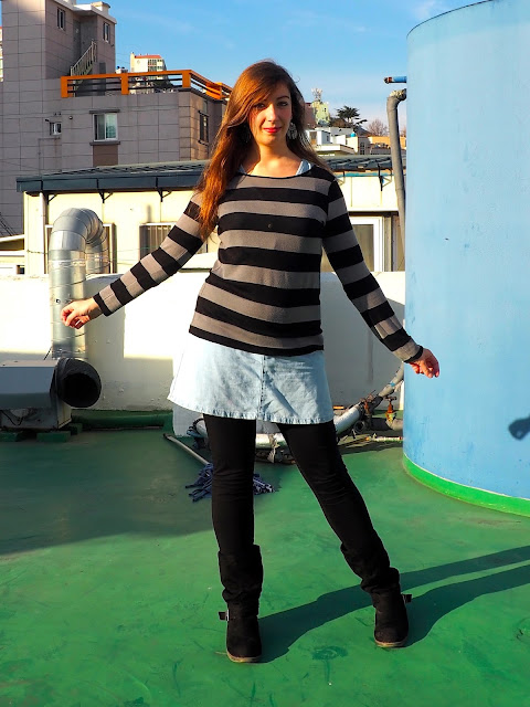 Sweater Weather | outfit of black and grey striped jumper worn over denim dress, with black legging and high boots