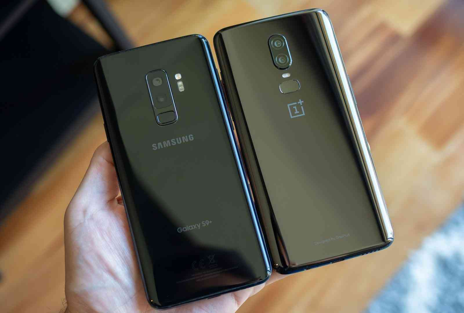 identical glass body designs on the Samsung Galaxy S9 Plus and the OnePlus 6 smart phone.