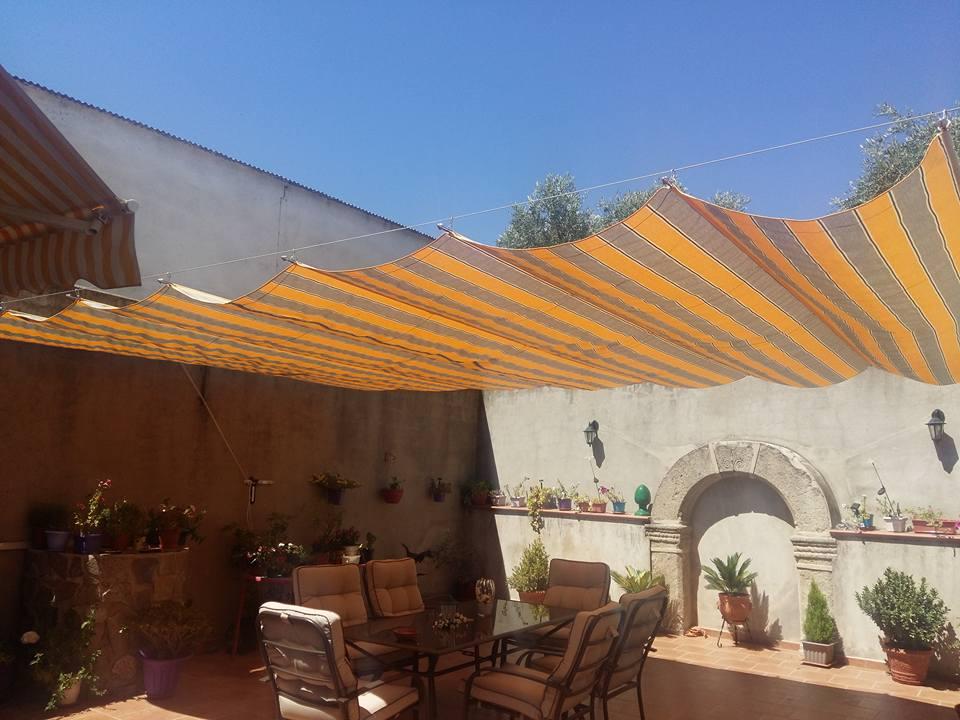 I d e a toldo casero exterior para patio for Ver toldos para patios