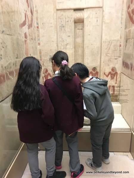 kids in Egyptian tomb at Metropolitan Museum of Art in NYC