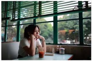 asian girl sad and waiting