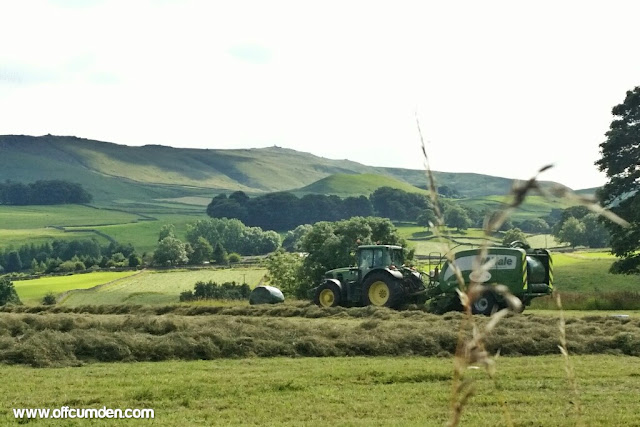 Tractor baling hay in the Yorkshire Dales