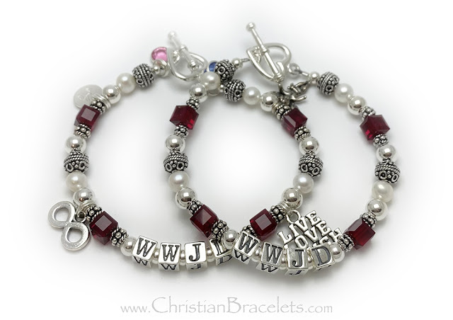 """The top WWJD bracelet is shown with red or July Birthstones and a Heart Toggle Clasp. Size: 7 1/2"""" The bottom WWJD bracelet is shown with 6 add-on charms: October birthstone, A - Initial Charm, Infinitiy Charm, Live Love Laugh Charm, Angel with Wings Charm and a September Birthstone Crystal. They picked 7 3/4"""" and added a Heart Toggle Clasp."""