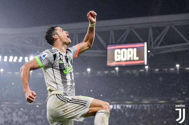 Cristiano Ronaldo celebrates scoring a late winner against Genoa as Juventus return to the top of the serie A