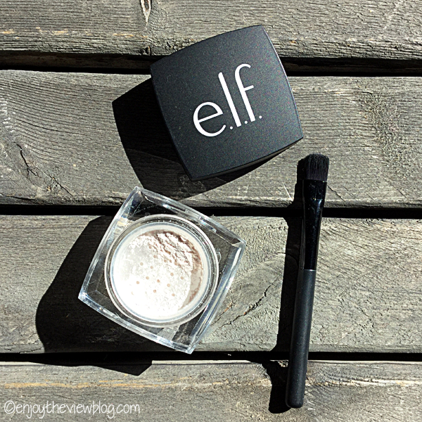 jar of elf undereye setting powder and small black brush