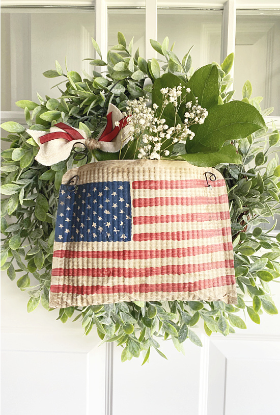 wreath with flag pouch on door