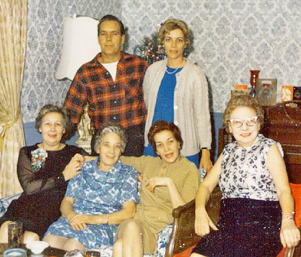 My grandmother (Nanny, seated in the middle in blue) with her surviving adult children.