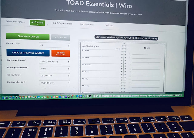 Photograph of an open MacBook computer with the TOAD diaries website open on the page for personalising diaries