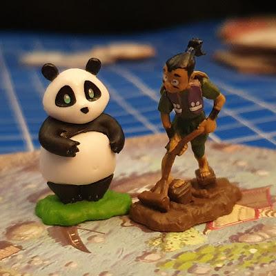 Takenoko game review gardener and panda figurines