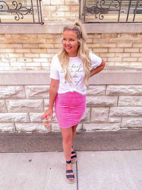 pink bodycon dress with graphic tee and sandals ways to wear a graphic tee