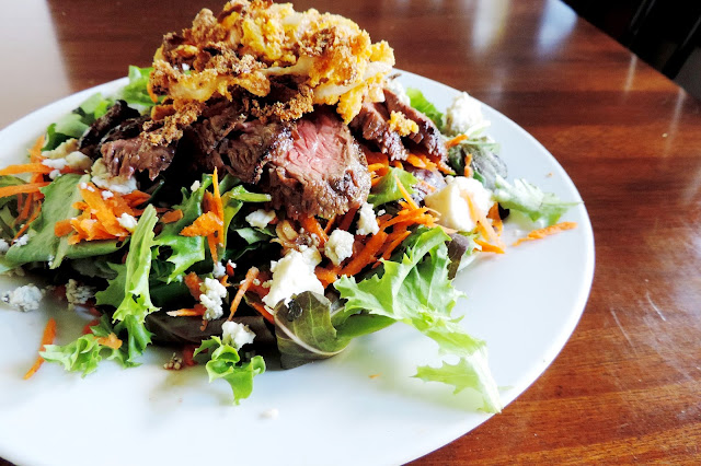 My finished Steakhouse Salad on a white plate.