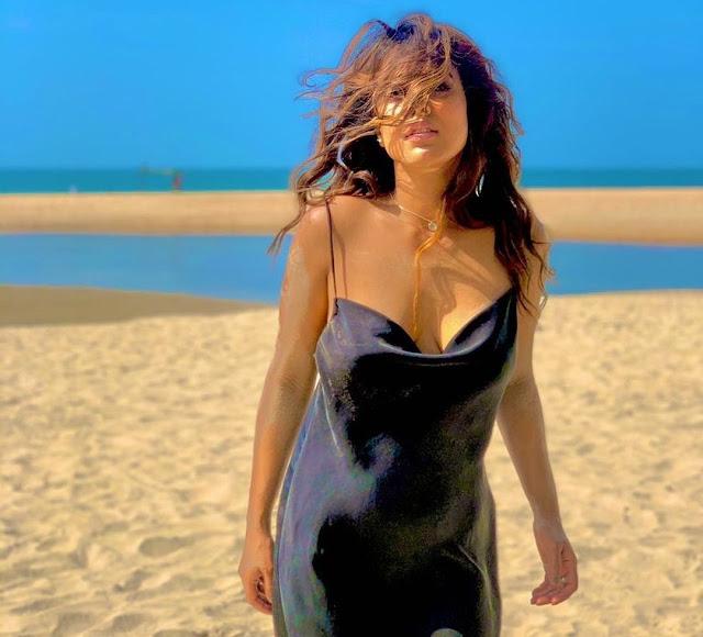 nia-sharma-steal-hearts-with-her-latest-photoshoot-in-black-dress- newsdezire