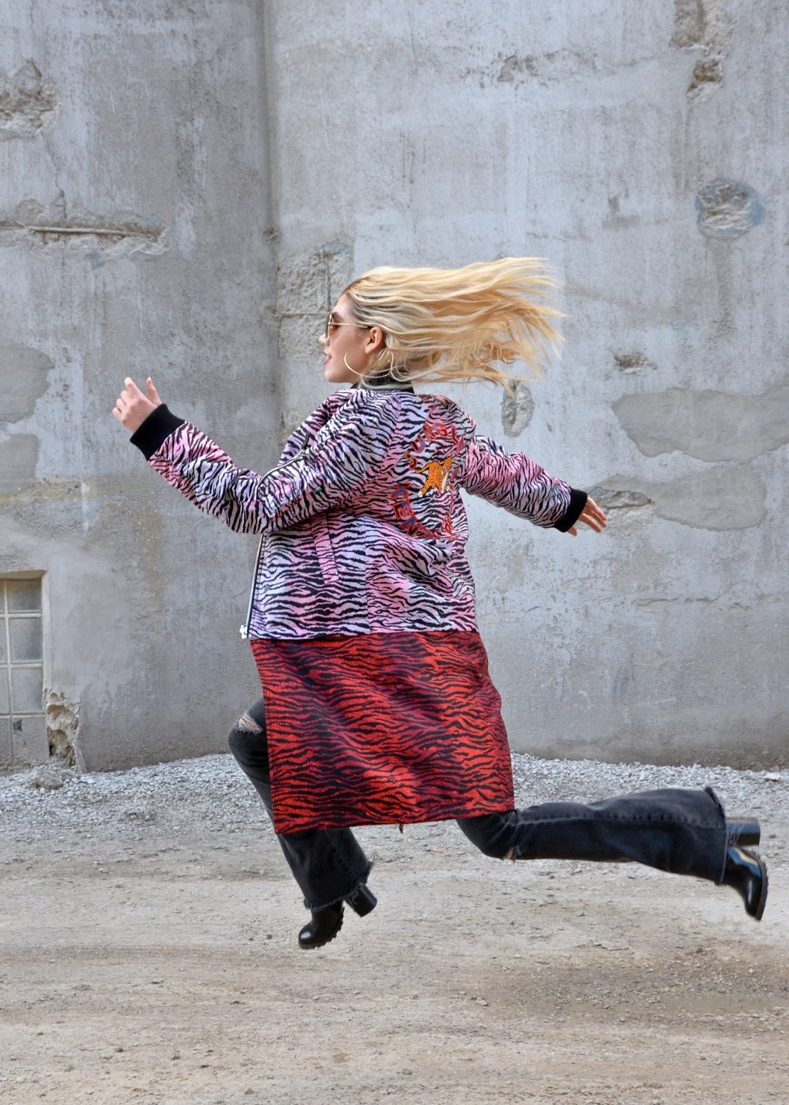 I am jumping in a Kenzo X H&M coat.