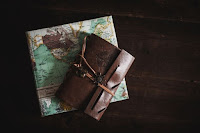 Scroll and map - Photo by Kira auf der Heide on Unsplash