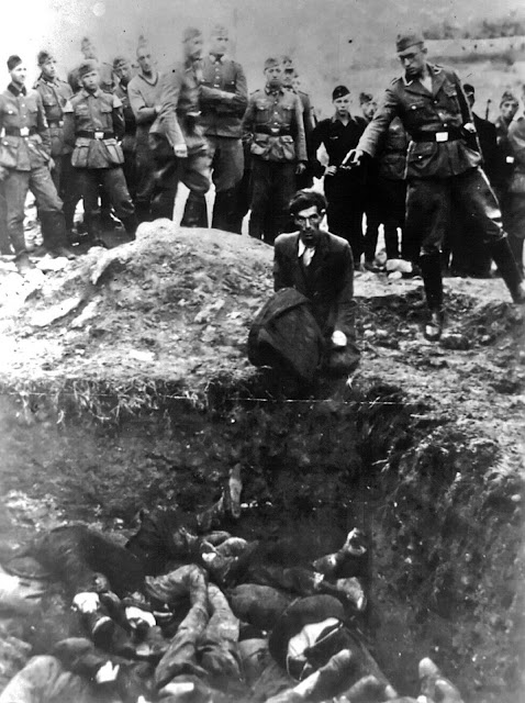 This photo provided by Paris' Holocaust Memorial shows a German soldier shooting a Ukrainian Jew during a mass execution in Vinnytsia, Ukraine, sometime between 1941 and 1943. This image is titled