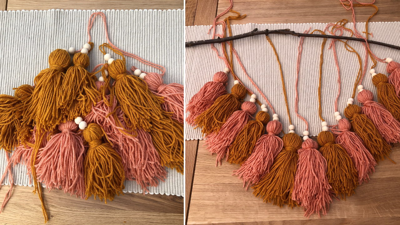 DIY boho style wall hanging made from wool or yarn. Perfect for a nursery or bedroom, this step-by-step tutorial will show you how to make a large feature decoration on a tight budget. Using a stick from the garden, and pink and yellow wool tassels. Nursery decor inspiration you can make yourself in this crafting tutorial.