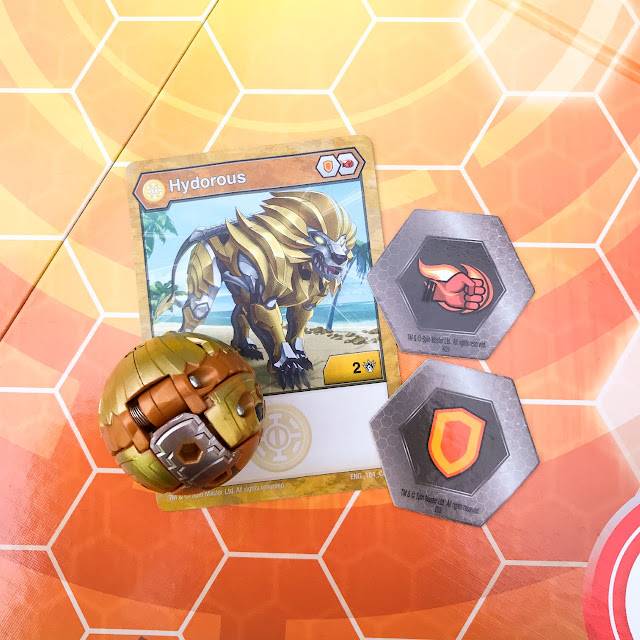 A single Bakugan ball along with the cards