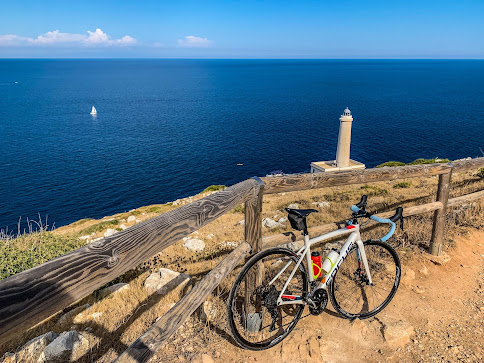carbon road bike rental in Otranto visit at the Faro della Palascia lighthouse