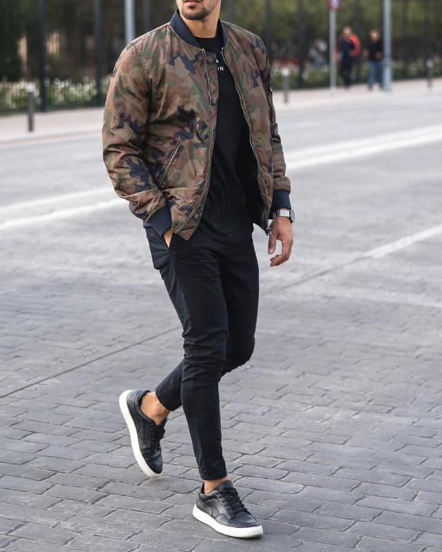 Man in Bomber jackets, crew neck sweatshirt and jeans.