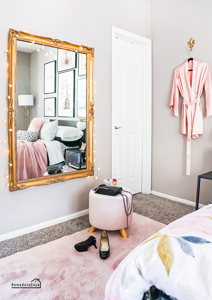 Gold ornate mirror, silky robe and pink details