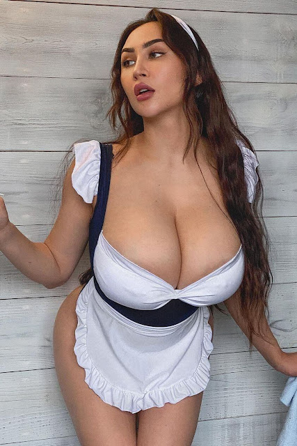 busty woman as sexy maid with big tits cleavage