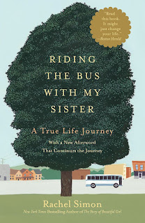 book cover, a tree with the title in the bough, and a bus on a street