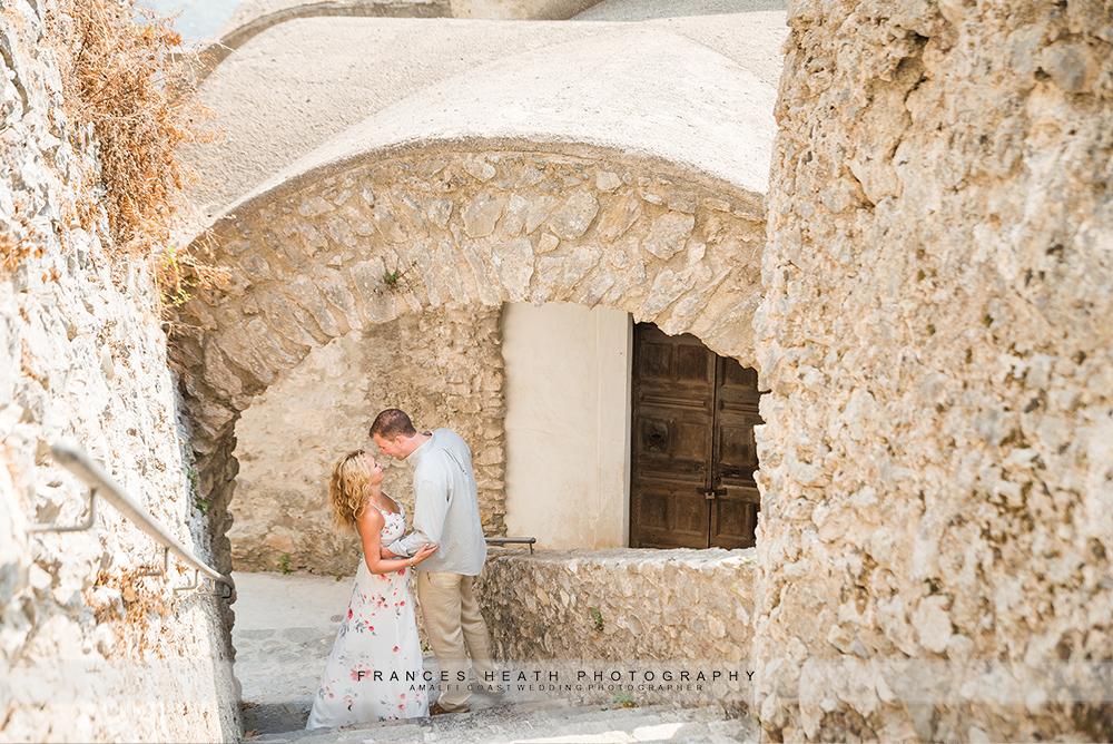 Ravello engagement couple under stone architecture