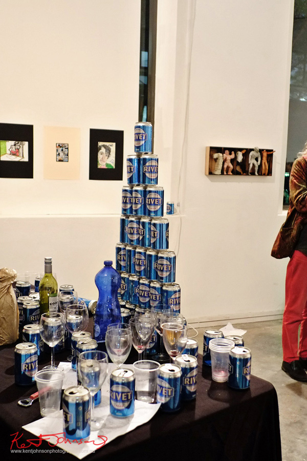 A pyramid of Rivet beer cans 2: 'Double Vision' MLS999. June 2016. Mils Gallery. h.j.huwman and Drano. Photography by Kent Johnson.