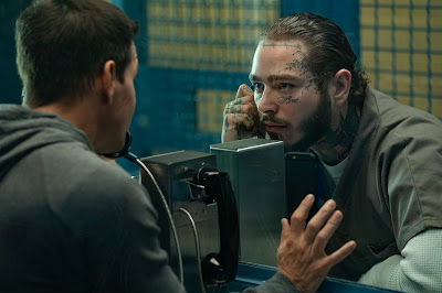 "Photo: Mark Wahlberg and Post Malone star in Netflix's ""Spenser Confidential."""