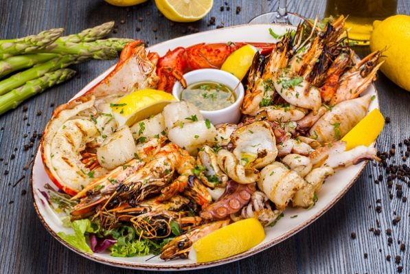 What are the benefits of seafood for a pregnant woman?