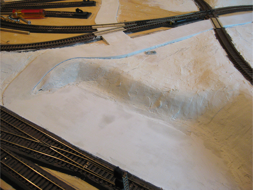 Leveled parking lot area made from Smooth-It road plaster for future freight station structure